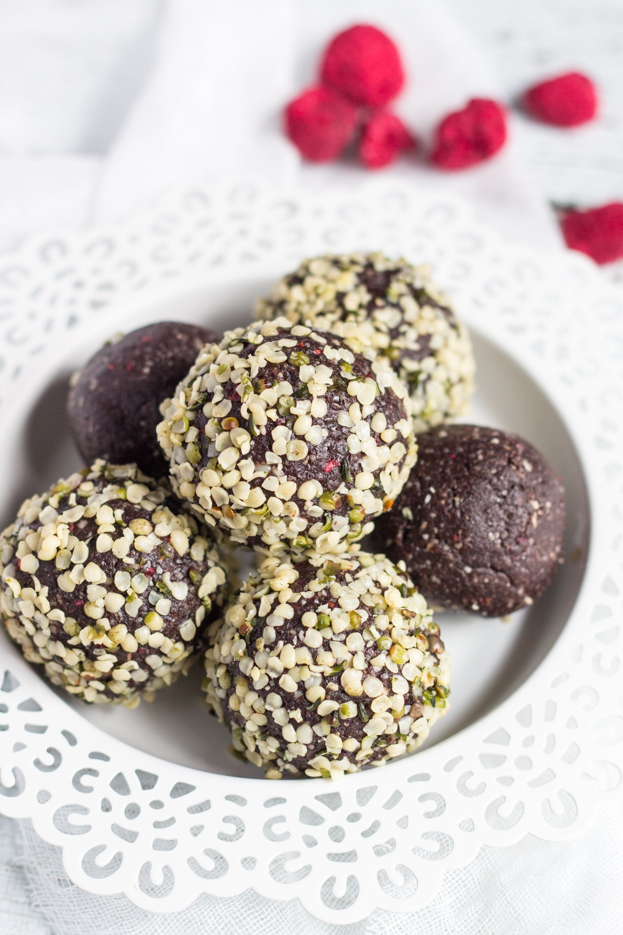 Nut Free Raspberry Bliss Balls. Dense, fudgy & great for tucking into kids lunchboxes. An easy way to increase protein in the diets of picky eaters.