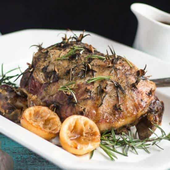 Slow Cooker Lamb Roast with Lemon, Rosemary & Garlic. The perfect answer to an easy mid-week meal. Just add some simple sides and dinner is done.