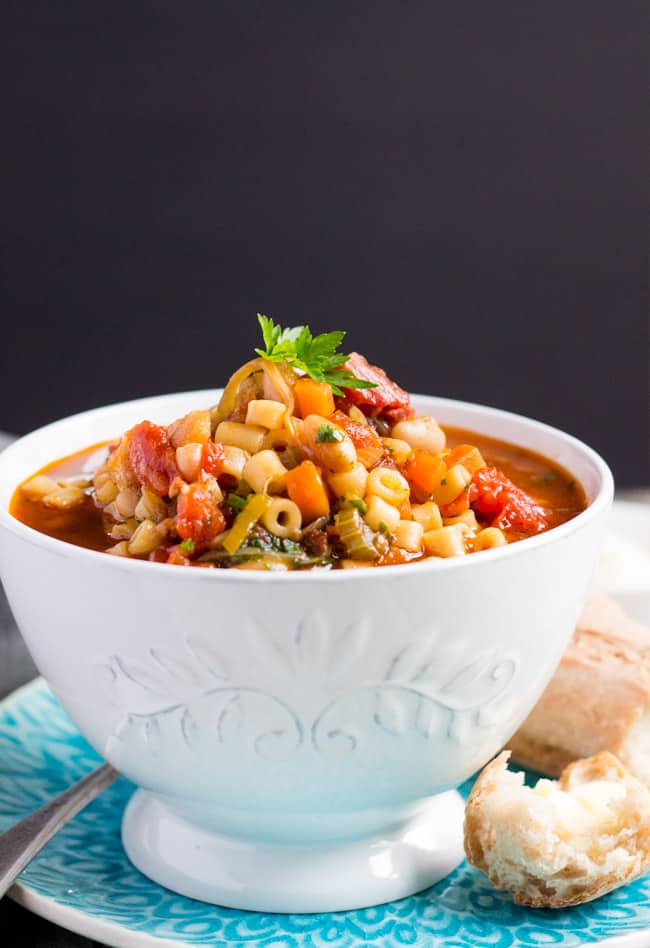 A bowl of easy minestrone soup with crusty bread on the side.