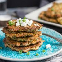 A stack of five zucchini & feta fritters, made with leftover quinoa.