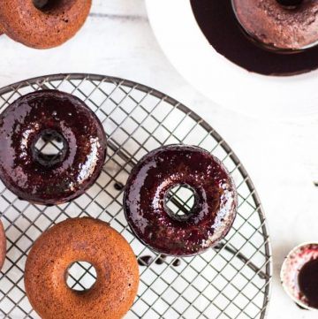 Baked Berry Spelt Doughnuts are quick to make, packed full of berries, and are the perfect size to tuck into a lunchbox.