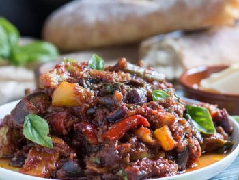 A white plate, piled high with an easy baked ratatouille recipe.