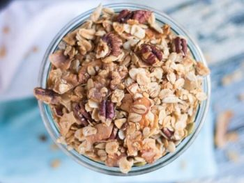 An overhead shot of a jar of homemade crunchy granola recipe.