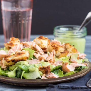 Leftover Salmon Caesar Salad. Turn leftover salmon into this simple Caesar salad with the addition of some crunchy croutons and a creamy avocado dressing.