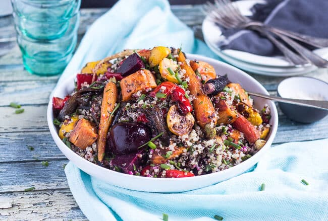 A Shallow White Bowl, Full Of Mediterranean Quinoa Salad, With The Roasted  Carrots,